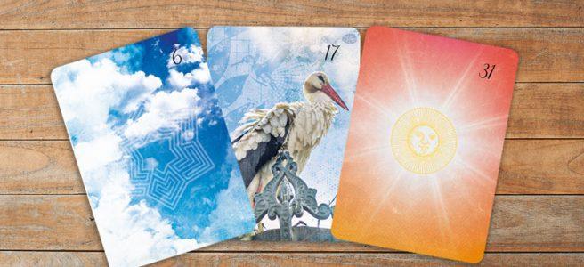Deutung der Lenormandkarten Kombination Wolken, Störche und Sonne